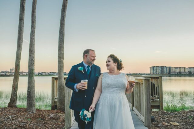 Wedding day stroll with coffee at sunset, but we'll stick it here this morning for a warm little start to the day like it's the crisp fall sunrise we Floridians have waited so patiently for. ☕️ Can we have sweaters yet?  🍁  Rachel and Matthew's dapper teal-colored wedding began with this little jaunt by the lake, and the waning light just picks up their colors so happily.   #imágemweddings #bythelake #orlandoweddingphotographer #weddingcoffee #thedapperdayphotographer